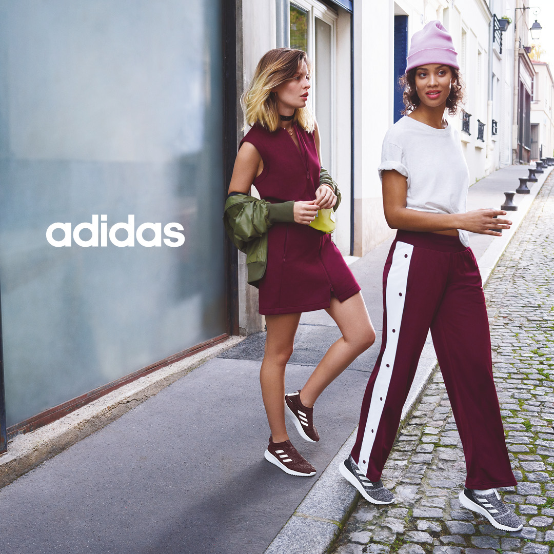 two fashionable women wearing pullon adidas sneakers