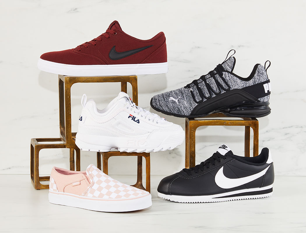 assorted sneakers by nike, fila, puma, and vans