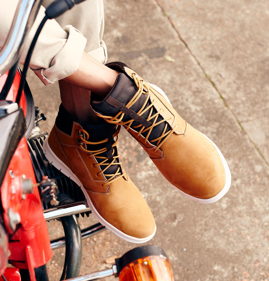 pair of timberland lace up boots