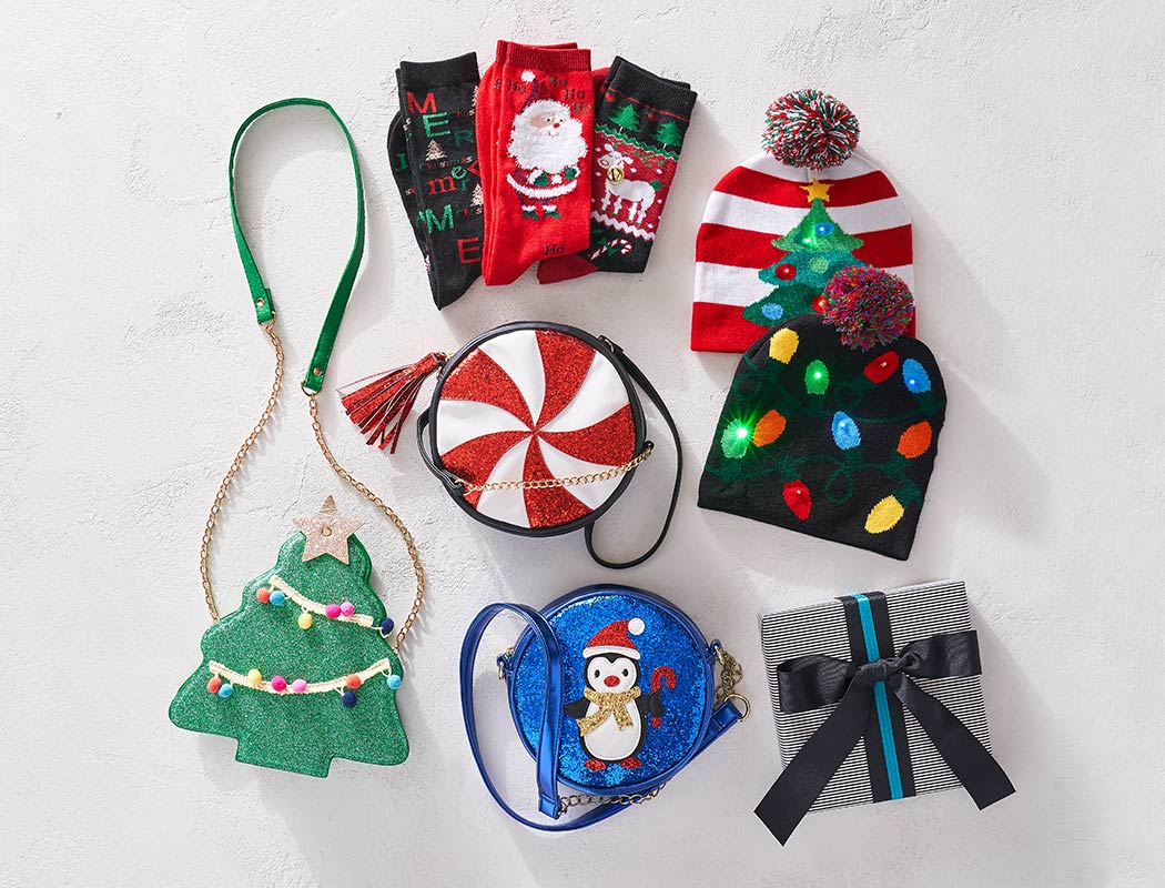 assorted holiday themed socks, hats, and purses