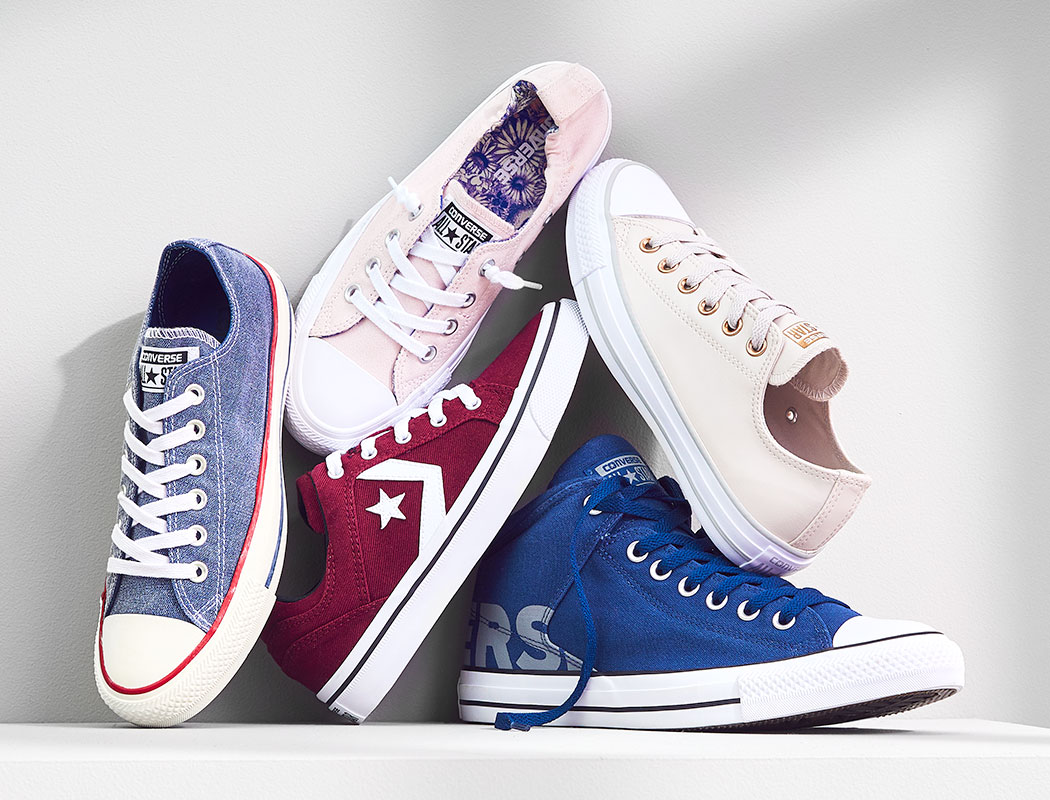 an assortment of converse sneakers