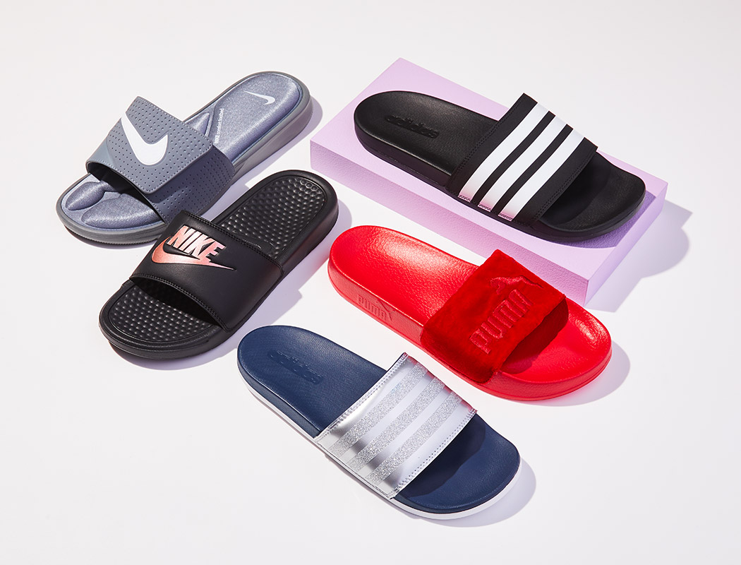 an assortment of nike, puma, adidas sport slides