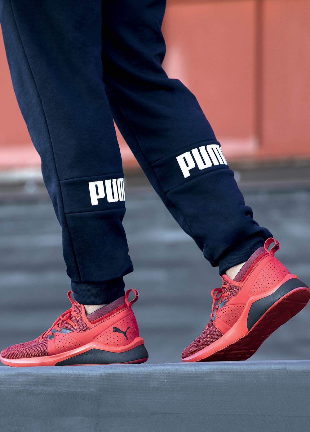 red mens puma athletic shoes