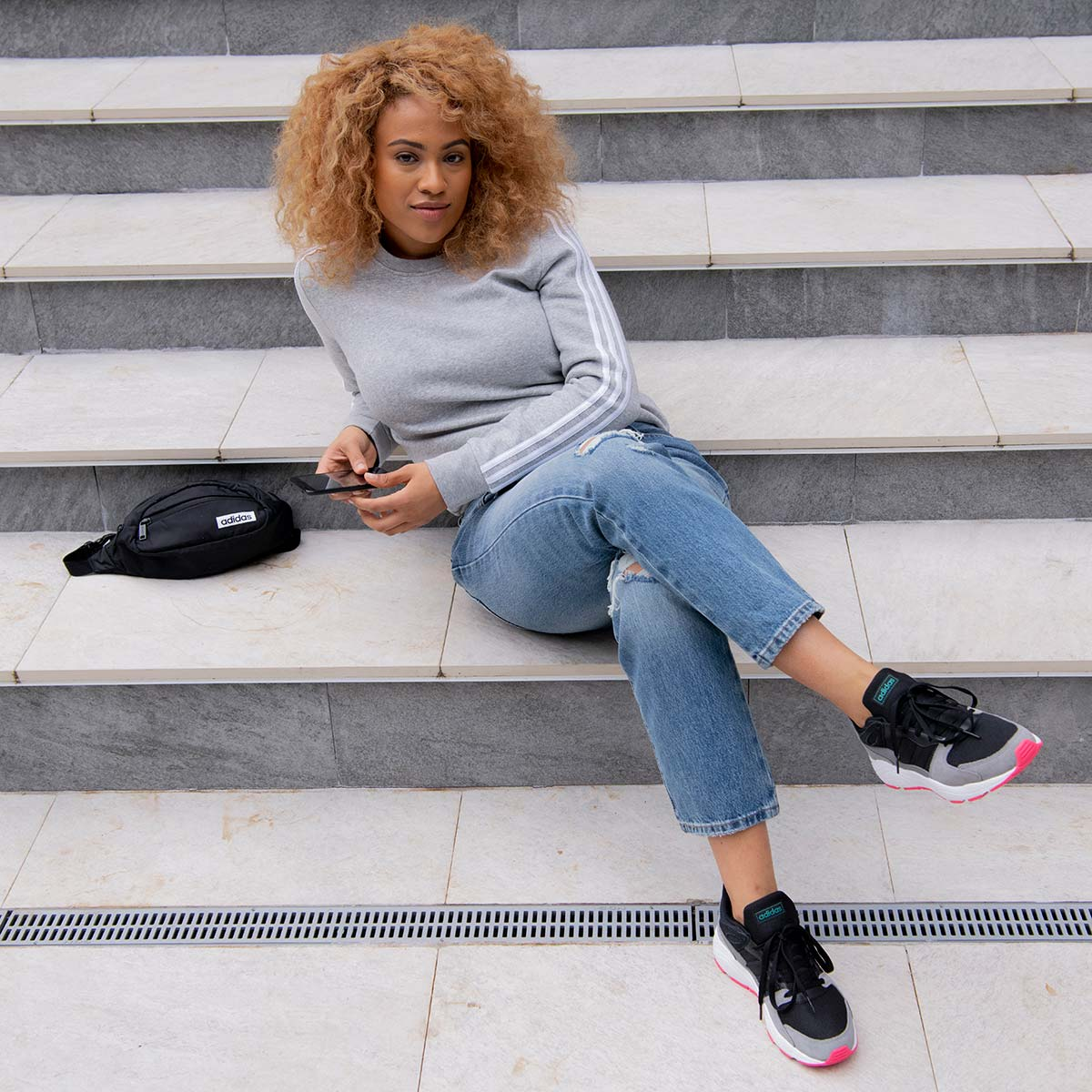 casual women wearing red adidas sneakers