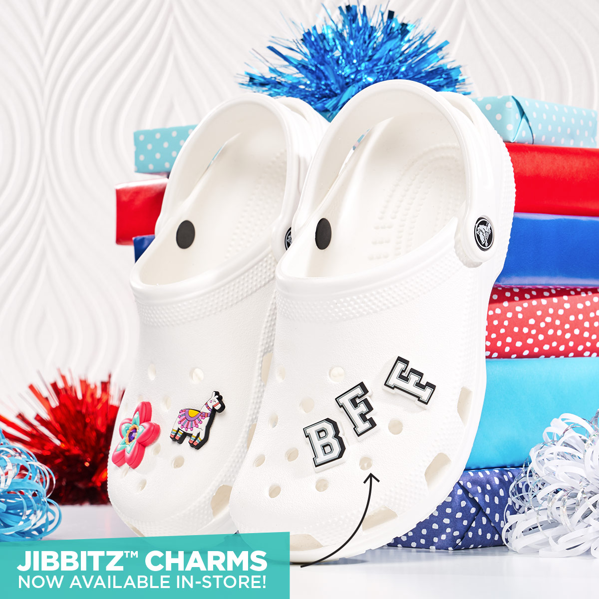 Pair of classic white crocs with jibbitz