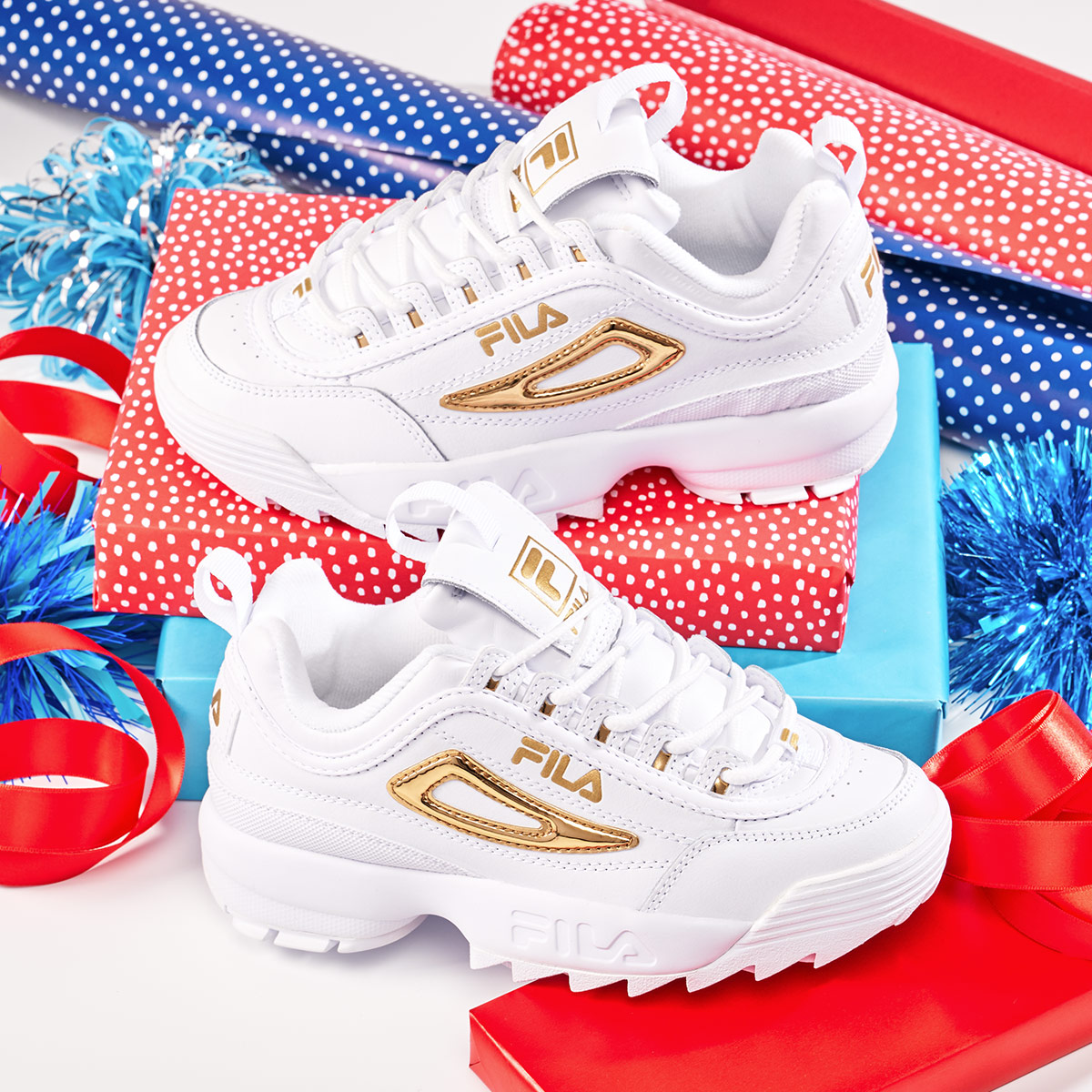 Pair of chunky Fila sneakers with flashy gold detail