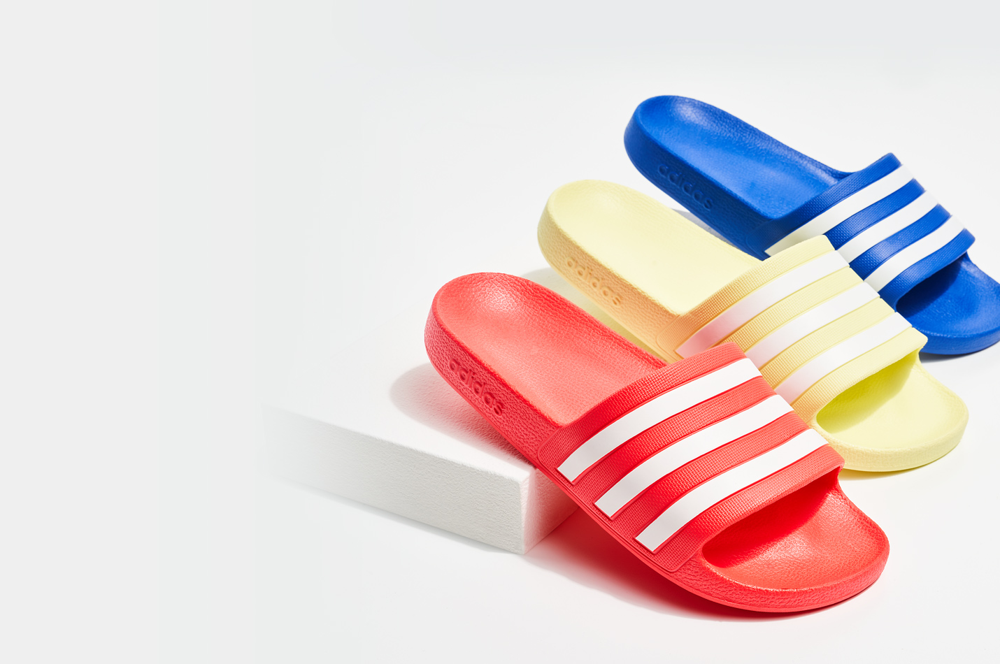 assorted adidas outdoor slides