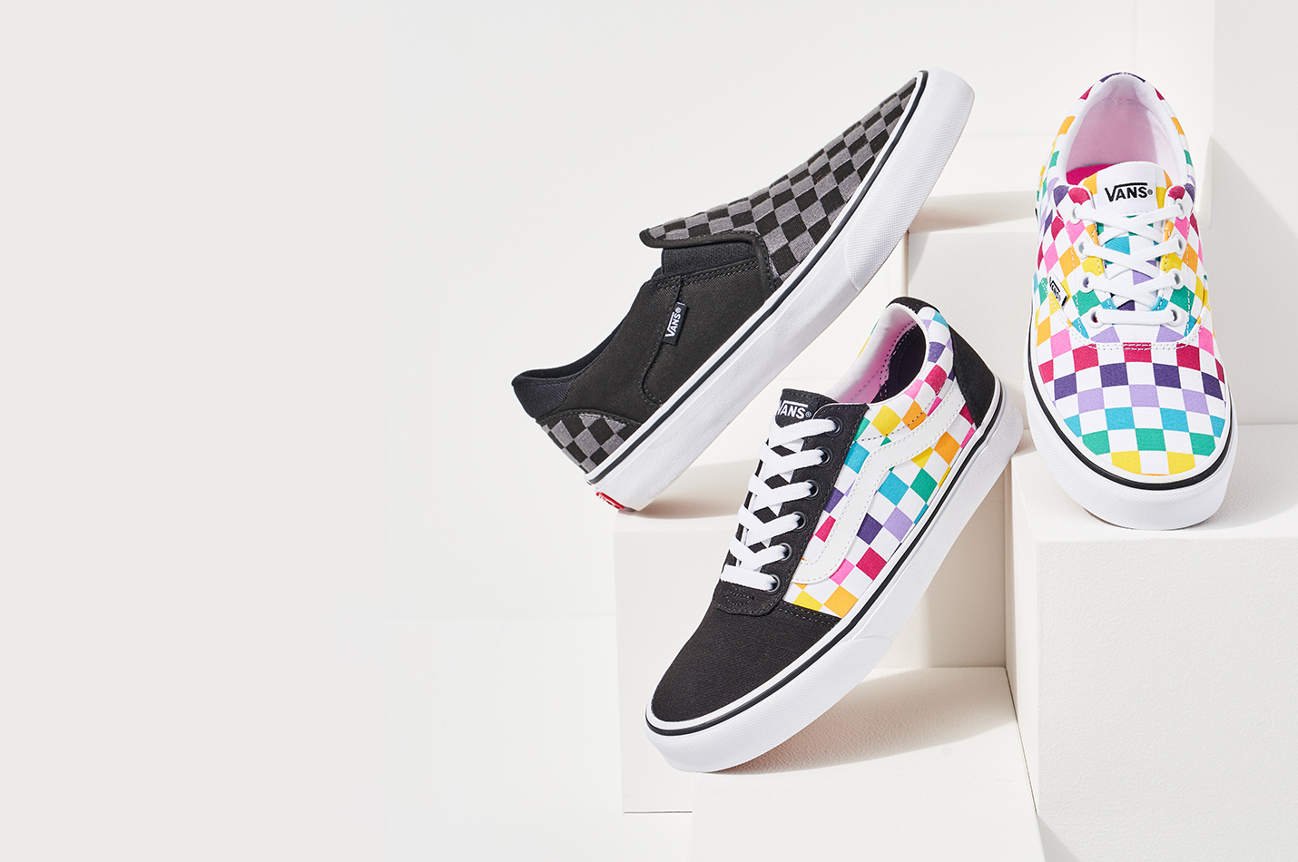 assorted checkered vans shoes